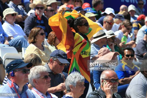 A Sri Lankan supporter cheers during the 2019 Cricket World Cup group stage match between Sri Lanka and South Africa at the Riverside Ground in...