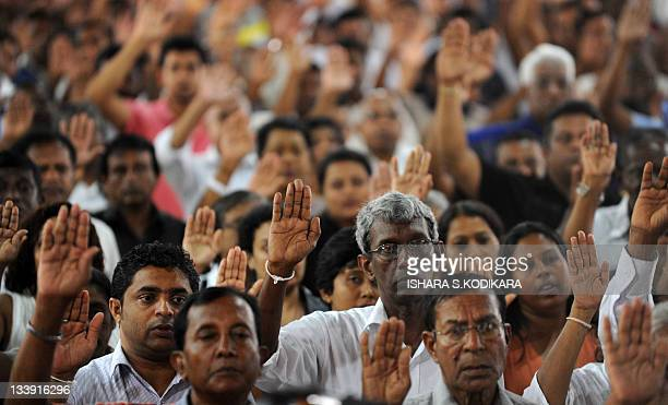 Sri Lankan supporters of jailed former army chief Sarath Fonseka take a pledge to join The People's Movement to Free Sarath Fonseka during the...