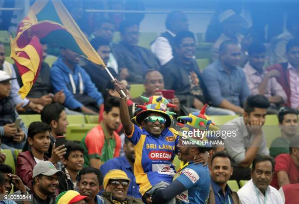 Sri Lankan supporters wave the national flag during the sixth One Day International match in the TriNations Series between Bangladesh and Sri Lanka...