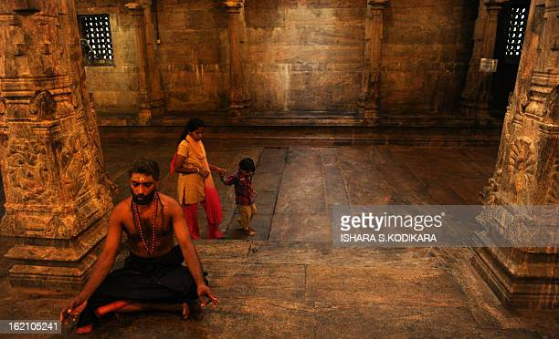 A Sri Lankan Tamil devotee offers prayers at a Hindu Temple in Colombo on January 15 2012 Hindus in Sri Lanka are celebrating the Thai Pongal...