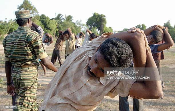 WITH SRI LANKAUNRESTTIGERSTRAINING A Sri Lankan Tamil Tiger guerrilla gives instuctions to villagers during a selfdefence training in the Liberation...