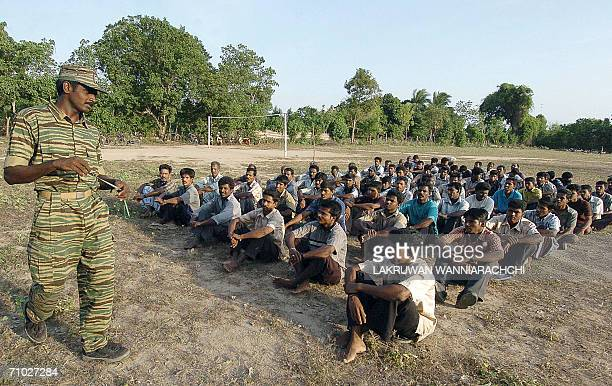 WITH SRI LANKAUNRESTTIGERSTRAINING A Sri Lankan Tamil Tiger guerrilla gives instuctions to villagers ahead of a selfdefence training in the...