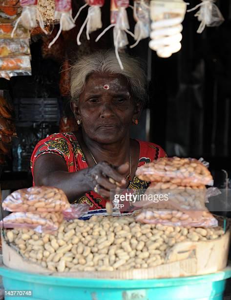A Sri Lankan tamil woman sells nuts in the northern town Kilinochchi on May 3 2012 Sri Lanka recorded an impressive 83 percent growth rate last year...