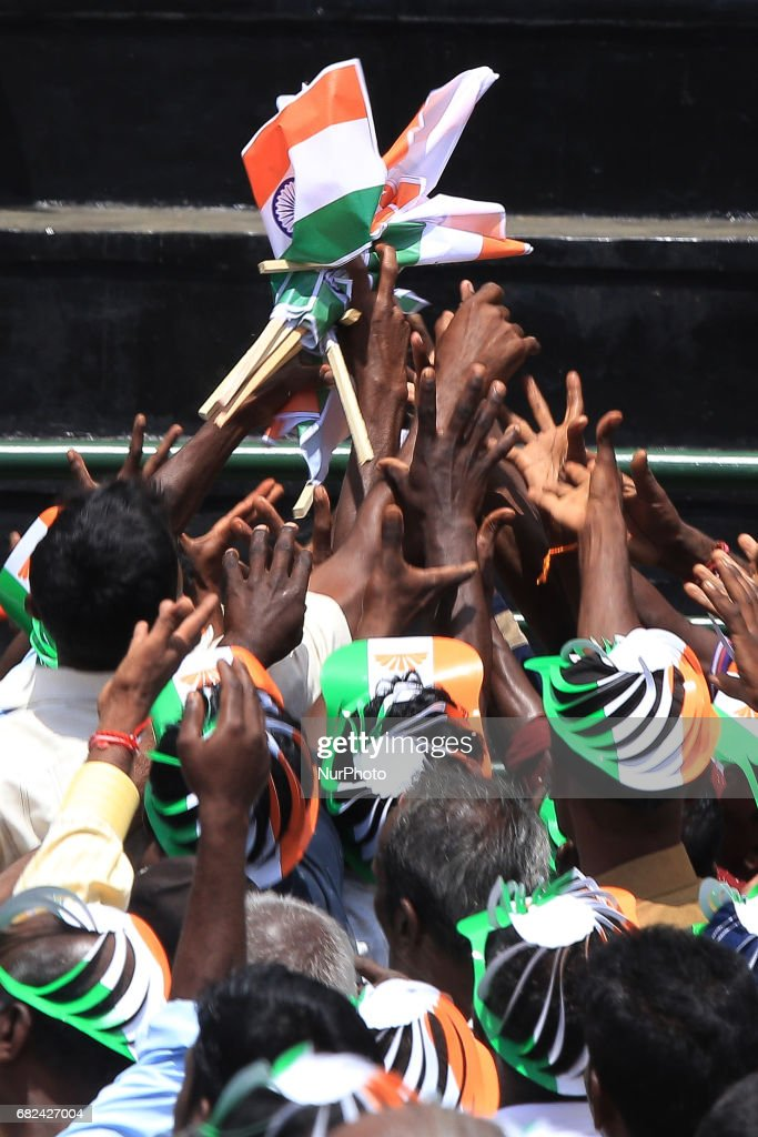 Sri Lankan tea plantation workers of Indian origin try to grab Indian flags during a rally attended by Indian PM Narendra Modi in Norwood, about 140 kilometers (87.5 miles) east of Colombo, Sri Lanka, Friday, May 12, 2017