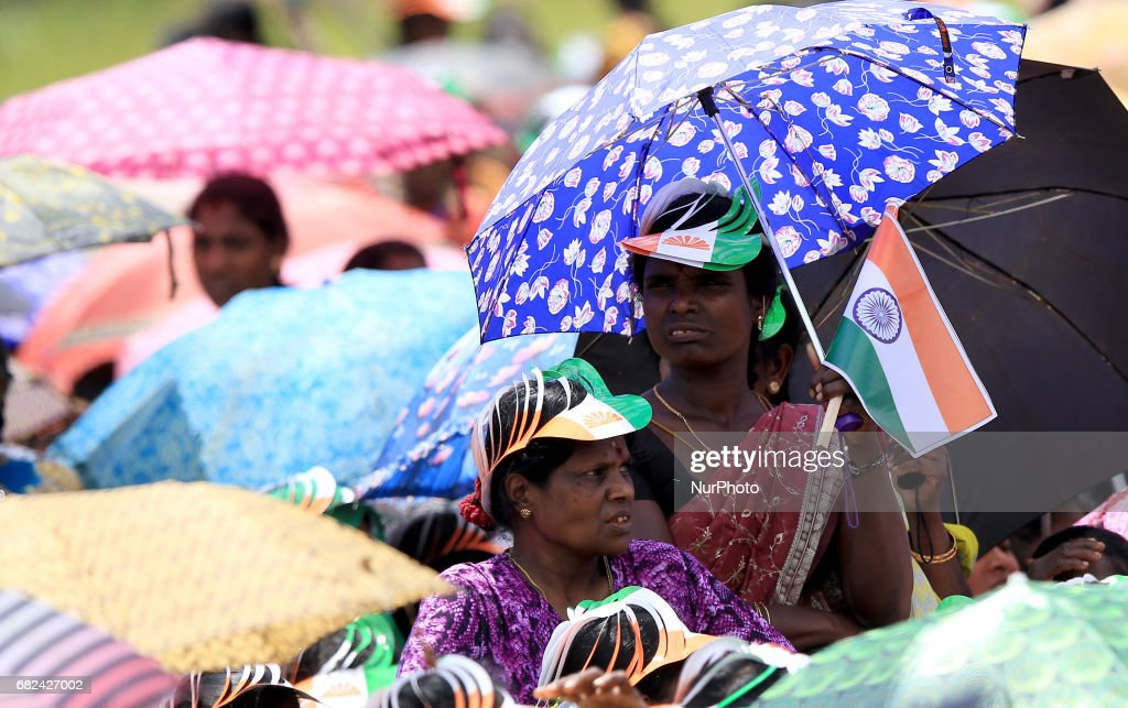 Sri Lankan tea plantation working women of Indian origin look on during a rally attended by Indian PM Narendra Modi in Norwood, about 140 kilometers (87.5 miles) east of Colombo, Sri Lanka, Friday, May 12, 2017
