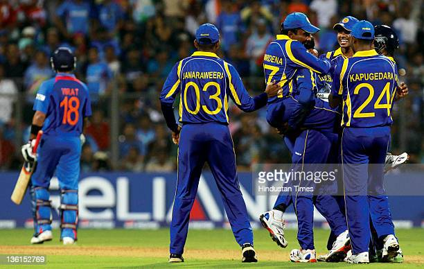 Sri Lankan team celebrates after taking the wicket of Indian batsman Virat Kohli during the 2011 ICC World Cup final match between India and Sri...