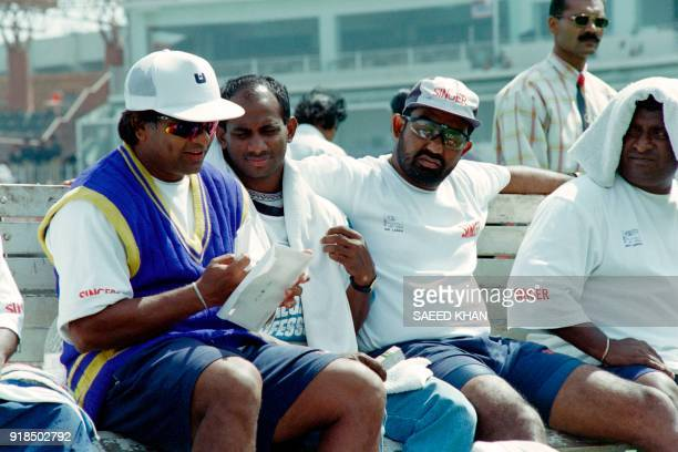 Sri Lankan team skipper Arjuna Ranatunga shares a letter with his two teammates Jayasuriya and Gurusinha during the practise session at Gaddafi...