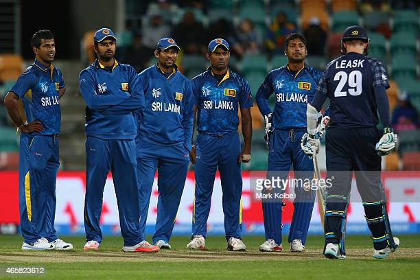 Sri Lankan team watch the replay on the big screen after sucessfully using a DRS challenge to take the wicket of Michael Leask of Scotland during the...