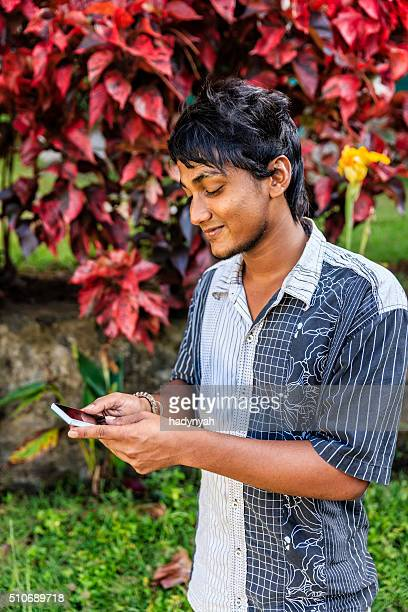 sri lankan teenager using mobile - sri lankan culture stock pictures, royalty-free photos & images