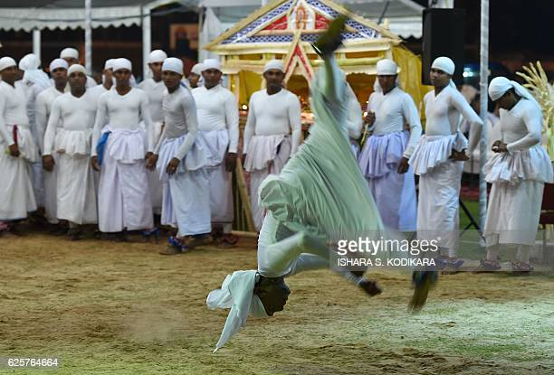 A Sri Lankan traditional dancer performs during the traditional ritual 'Gammaduwa' ceremony in Colombo on November 25 2016 'Gammaduwa' shanthikarmais...