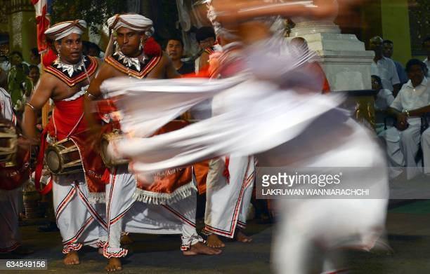 Sri Lankan traditional Kandyan dancers perform during a procession in front of the Gangarama Temple as part of the Navam Perahera festival in Colombo...