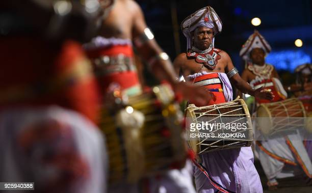 Sri Lankan traditional Kandyan musicians perform during a procession in front of The Gangarama Temple in Colombo on March 1 during The Navam Perahera...