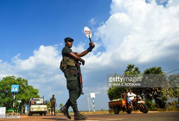 A Sri Lankan trooper stops a vehicle on a road blocked in the district of Mullaittivu on May 17 ahead of the 10th anniversary of Sri Lankan troops...