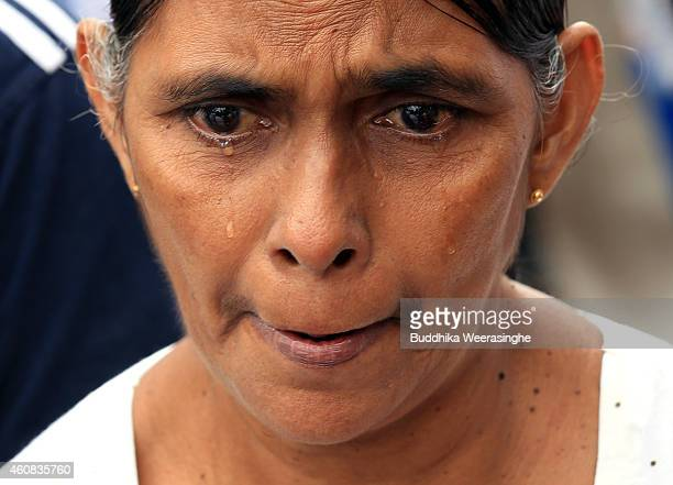 Sri Lankan tsunami survivor cries as she prays for victims at a special memorial monument to commemorate the victims of the 2004 Boxing Day tsunami...