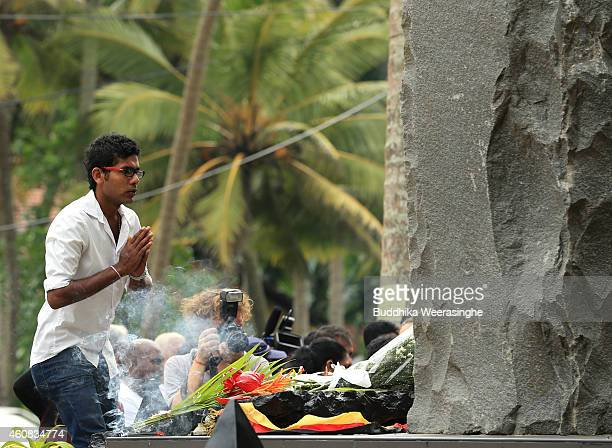 Sri Lankan tsunami survivor prays for victims at a special memorial monument to commemorate the victims of the 2004 Boxing Day tsunami on December 26...