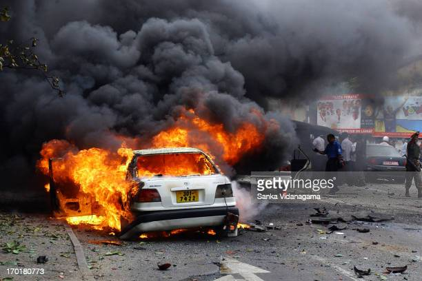 Sri Lankan vehicle is engulfed by flames near the convoy of Sri Lankan Defence Ministry Secretary Gotabaya Rajapakse after a suicide bomb attack in...