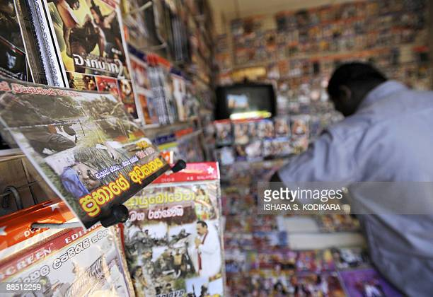 A Sri Lankan vendor sells a video compact disc showing the death of Tamil Tiger chief Velupillai Prabhakaran in Colombo on June 16 2009 CDs showing...