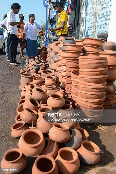 A Sri Lankan vendor sorts clay pots as customers shop in Colombo on April 13 ahead of the traditional Sinhala and Tamil New Year Sri Lanka marks the...