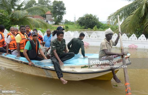 Sri Lankan villagers are evacuated through floodwaters in Nagoda in Kalutara district on May 29 2017 Sri Lanka's monsoon toll climbed to 164 with the...