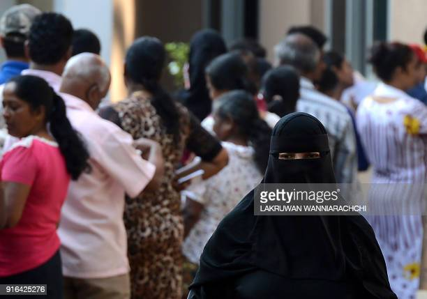A Sri Lankan voter leaves after casting their ballot at a polling station in Colombo on February 10 2018 The poll to elect 340 local government...
