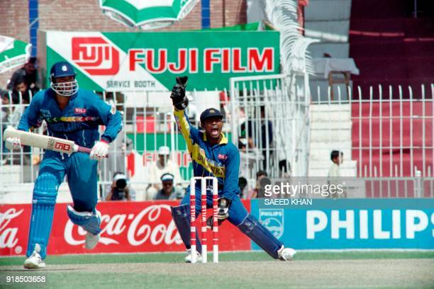 Sri Lankan wicket keeper Kaluwitharana appeals confidently for LBW against England's highest scorer Philip DEfreitas during the first quarterfinal of...
