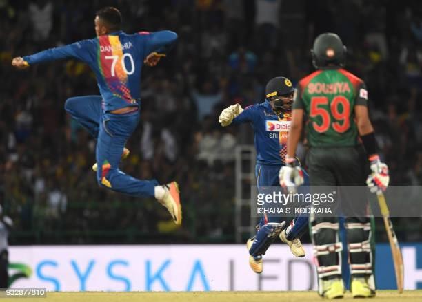 Sri Lankan wicketkeeper Kusal Perera and Danushka Gunathilaka celebrate as they dismiss Bangladesh cricketer Tamim Iqbal during the sixth Twenty20...