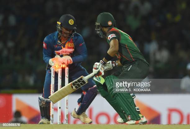 Sri Lankan wicketkeeper Kusal Perera attempts to stump Bangladesh cricketer Sabbir Rahman during the sixth Twenty20 international cricket match...