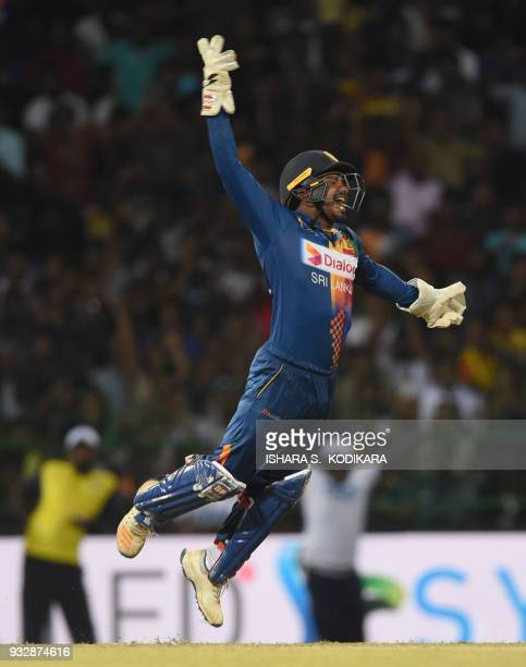 Sri Lankan wicketkeeper Kusal Perera celebrates taking a catch to dismiss Bangladesh cricketer Tamim Iqbal during the sixth Twenty20 international...