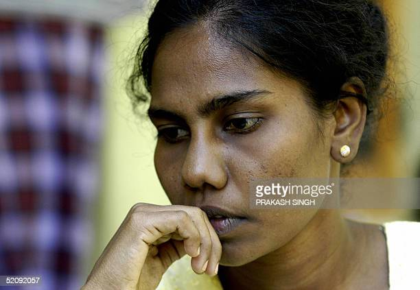 Sri Lankan woman Junitha Jeyarajah who claims to be the mother of a baby boy who grabbed world media attention as a 'celebrated' tsunami orphan waits...