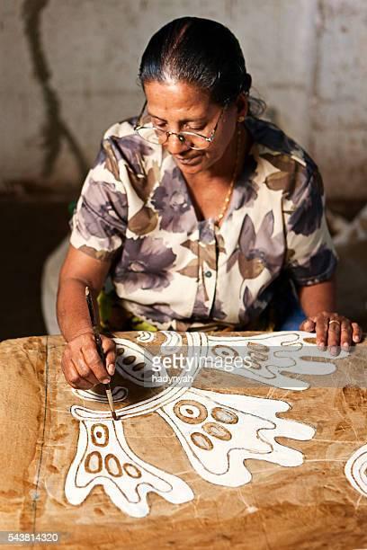 Sri Lankan woman making batik near Kandy
