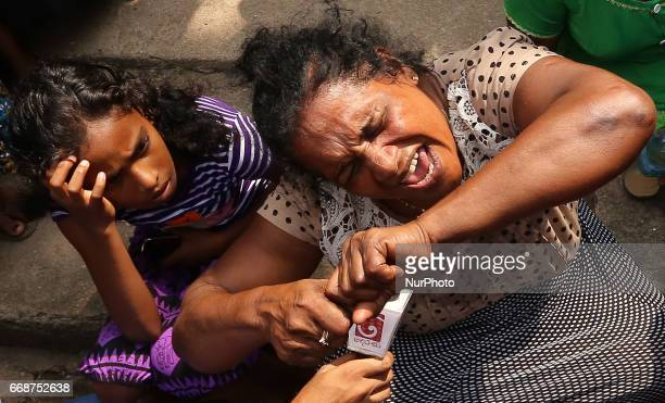 A Sri Lankan woman mourns her dead relative following a garbage mountain collapsed in Colombo Sri Lanka 15 April 2017 A large section of garbage dump...