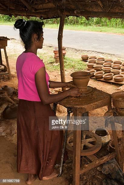 Sri Lankan woman throwing pottery