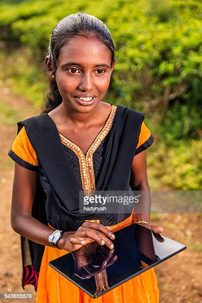 Sri Lankan young girl using a digital tablet, Nuwara Eliya