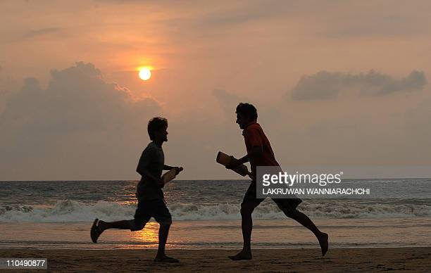 Sri Lankan youngsters play cricket on a beach in Colombo on March 20 2011 The Cricket World Cup tournament is cohosted by Sri Lanka with Bangladesh...