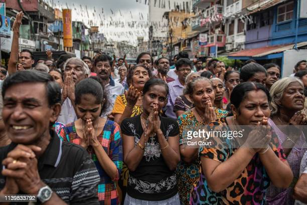 Sri Lankans pray in the street near St Anthony's Shrine one week on from the attacks that killed over 250 people on April 28 2019 in Colombo Sri...