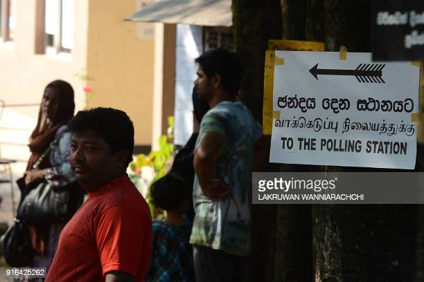 Sri Lankans queue up to cast their vote in the country's election at a polling station in Colombo on February 10 2018 The poll to elect 340 local...