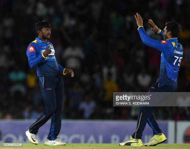 Sri Lanka's Akila Dananjaya and Dhananjaya de Silva celebrate dismissing South Africa's Aiden Markram during the second oneday international cricket...