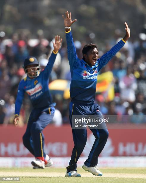 Sri Lanka's Akila Dananjaya appeals to Zimbabwe's cricketer Solomon Mire during the first oneday international cricket match between Sri Lanka and...