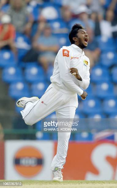 Sri Lanka's Akila Dananjaya celebrates after dismissing England's captain Joe Root during the third day of the second Test match between Sri Lanka...