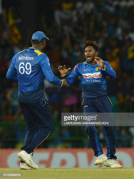 Sri Lanka's Akila Dananjaya celebrates with his teammate Angelo Mathews after he dismissed South Africa's Heinrich Klaasen during the fifth and final...