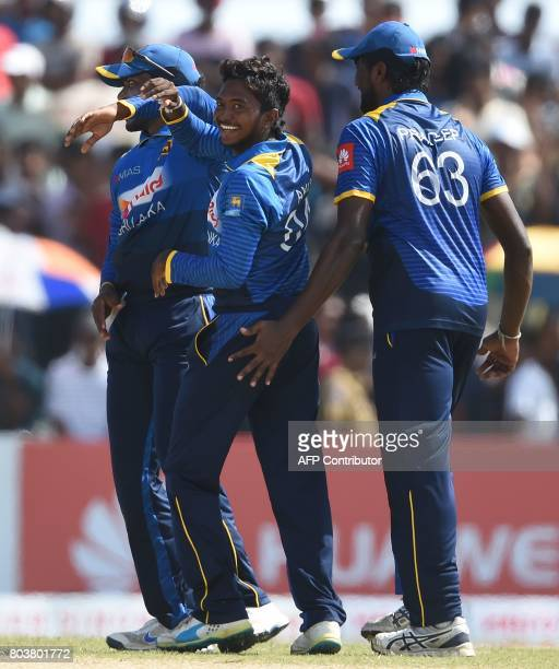 Sri Lanka's Akila Dananjaya celebrates with his teammates after he dismissed Zimbabwe's Craig Ervine during the first oneday international cricket...