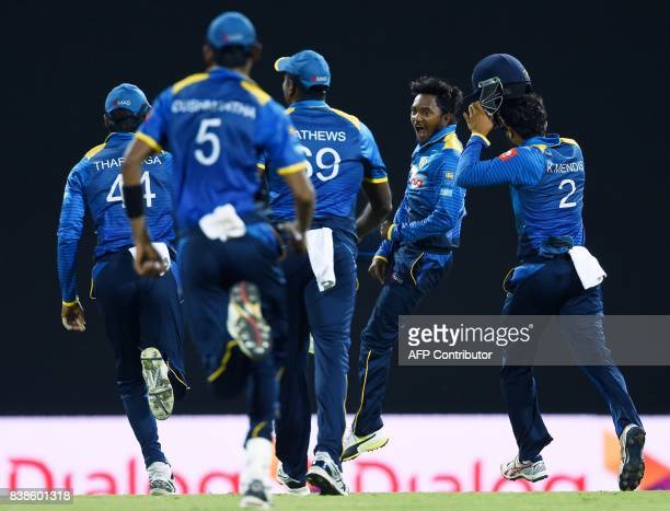 Sri Lanka's Akila Dananjaya celebrates with his teammates after he dismissed Indian cricket captain Virat Kohli during the second One Day...