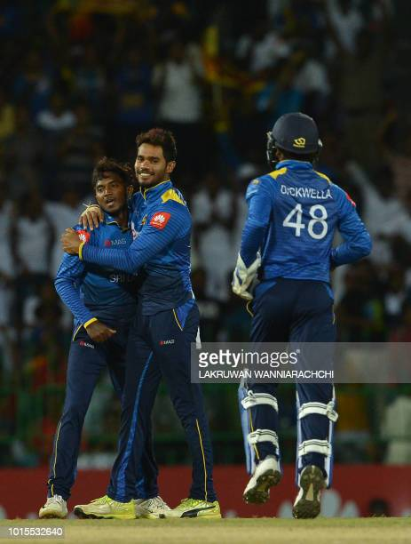 Sri Lanka's Akila Dananjaya celebrates with teammate Dhananjaya de Silva after he dismissed South Africa's Aiden Markram during the fifth and final...