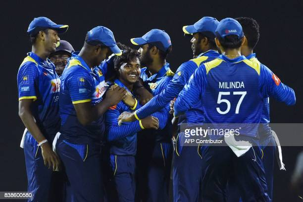 Sri Lanka's Akila Dananjaya celebrates with teammates after he dismissed Indian cricket captain Virat Kohli during the second One Day International...
