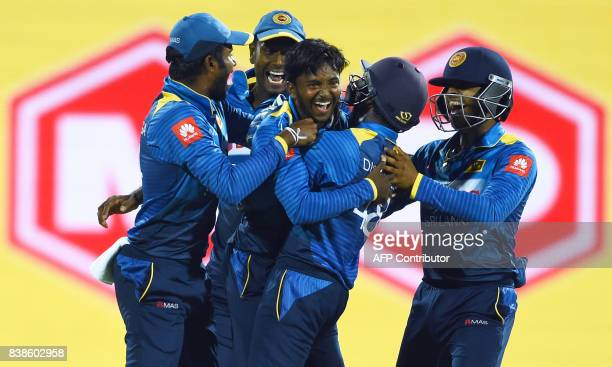 Sri Lanka's Akila Dananjaya celebrates with teammates after he dismissed Indian cricketer Lokesh Rahu during the second One Day International cricket...