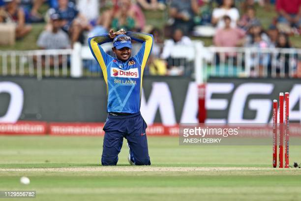 Sri Lanka's Akila Dananjaya reacts after missing a chance to run out South Africa's David Miller during the third one day international cricket match...
