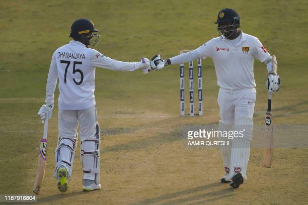 Sri Lanka's Angelo Mathews and Dhananjaya De Silva react during the first day of the first Test cricket match between Pakistan and Sri Lanka at the...
