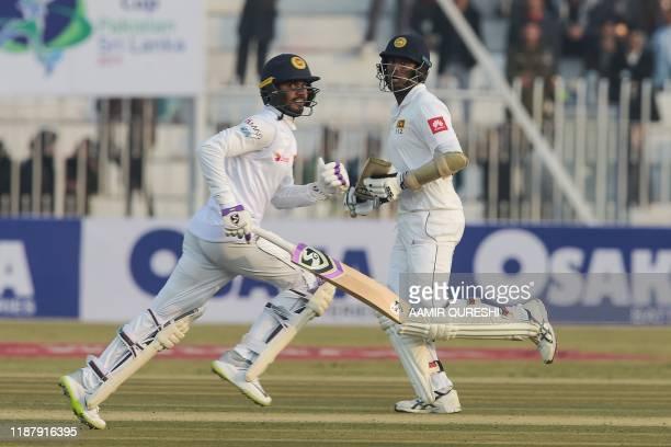 Sri Lanka's Angelo Mathews and Dhananjaya De Silva take a run during the first day of the first Test cricket match between Pakistan and Sri Lanka at...