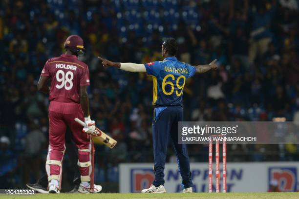 Sri Lanka's Angelo Mathews celebrates after he dismissed West Indies Jason Holder during the third one day international cricket match between Sri...