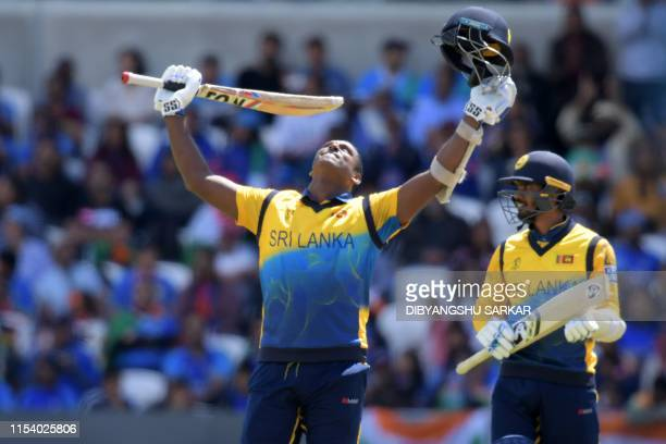 TOPSHOT Sri Lanka's Angelo Mathews celebrates reaching his century during the 2019 Cricket World Cup group stage match between Sri Lanka and India at...